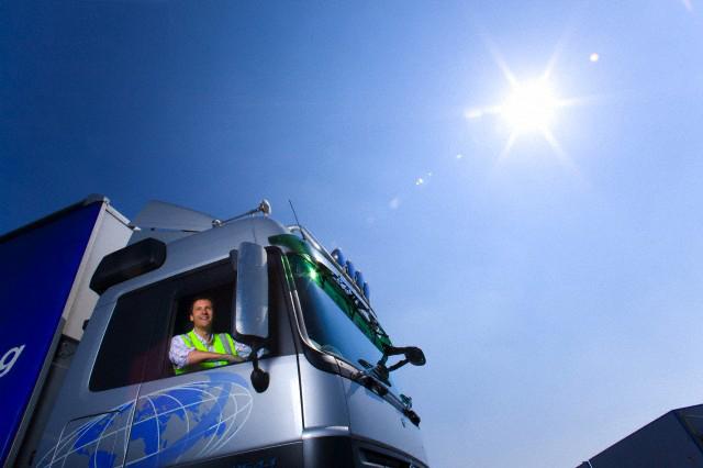 Truck driver driving semi-truck